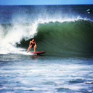 Abby surfing